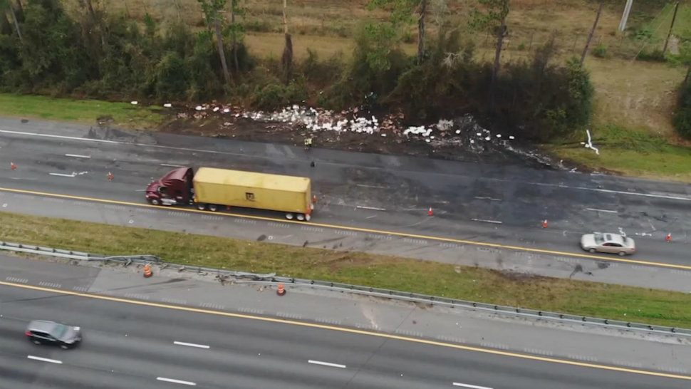 The aftermath of a fiery crash on Interstate 75 is seen in a screen capture from drone video Friday. The crash south of Gainesville left 7 people dead, including the drivers of 2 semitractor-trailers and 5 children in a church van heading to Disney World. (Tony Rojek/Spectrum News)